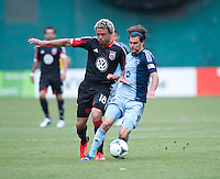Graham Zusi (8) of Sporting Kansas City fights for the ball with Nick DeLeon (18) of D.C. United during a Major League Soccer match at RFK Stadium in Washington, DC.  D.C. United tied Sporting Kansas City, 1-1.