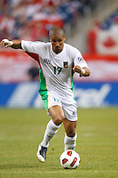 Guadeloupe midfielder Cedric Collet (17) dribbles the ball during the CONCACAF soccer match between Panama and Guadeloupe at Ford Field Detroit, Michigan.