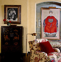 A 19th century Chinese ancestral portrait and a lacquered Chinese cabinet give an Oriental feel to the living room