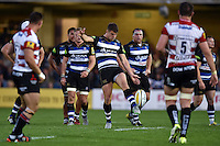 Ollie Devoto of Bath Rugby kicks for touch. West Country Challenge Cup match, between Bath Rugby and Gloucester Rugby on September 26, 2015 at the Recreation Ground in Bath, England. Photo by: Patrick Khachfe / Onside Images