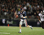 Ole Miss quarterback Bo Wallace (14) runs vs. Texas A&amp;M in Oxford, Miss. on Saturday, October 6, 2012. Texas A&amp;M won 30-27...