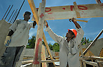 Emma Saint Louis Telusma (right) and Nixon Manigat help construct a new school in the Puits Blain neighborhood of Port-au-Prince, Haiti. The construction is supported by the United Methodist Committee on Relief (UMCOR) and Volunteers in Mission, as part of their work in Haiti after the 2010 earthquake..