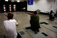 Friday, May 2nd 2008.  Point Loma High School San Diego, CA, USA. Alex Dolphin, Sean Spratt and Logan Watson of the Point Loma High School Junior ROTC take aim with their air rifles during target practice at the firing range on the high school's campus.  The school board voted to ban target practice on campus, Tuesday, Feburary 10 2009.  Critics sited the murder of local MBHS student Hannah Podhorskey amongst three shootings of local high school students as one of the reasons that they feel the practice is unacceptable.