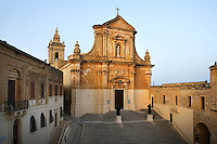 High angle view of the 17th century Cathedral in the Citadella, Victoria, Gozo, Malta, pictured on June 2, 2008, in the afternoon. The Republic of Malta consists of seven islands in the Mediterranean Sea of which Malta, Gozo and Comino have been inhabited since c.5,200 BC. Nine of Malta's important historical monuments are UNESCO World Heritage Sites, including the Citadella, which has been a fortified city since the Bronze Age. Sited on a hill above Victoria (or Rabat) which dominates the surrounding countryside and coast, it was built up by the Phoenicians and then the Romans into a complex Acropolis. In the Middle Ages the Citadel was used as a refuge for the population by the Order of the Knights of St John. In 1551 the island was attacked by Muslims and the population taken away into slavery. Picture by Manuel Cohen.