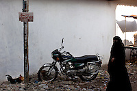 A women walks down a narrow street in Dharavi on 12th Dec 2006. An estimated 70% of Dharavi's population is muslim.