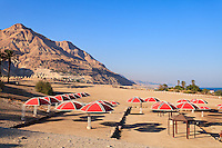 Judean Desert hills are the backdrop for the public beach at Ein Gedi on the western Dead Sea coast.