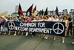 "Demonstration CND Campaign Nuclear Disarmament London to Hyde Park 1982  against the conflict in the Falklands. CND women march against war in the Falklands through streets London. Joan Ruddock Labour MP - centre in red coloured open neck shirt wearing white trousers behind the ""MPA"" of Campaign."