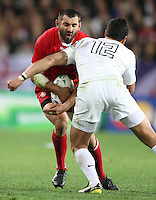 Georgia's Tedo Zibzibadze, left, in the tackle of England's Shontayne Hape in the Rugby World Cup pool match at Otago Stadium, Dunedin, New Zealand, Sunday, September 18, 2011. Credit:SNPA / Dianne Manson.