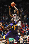 "Mississippi's Murphy Holloway (31) shoots over LSU's Johnny O'Bryant III (2) at the C.M. ""Tad"" Smith Coliseum in Oxford, Miss. on Saturday, February 25, 2012. (AP Photo/Oxford Eagle, Bruce Newman).."