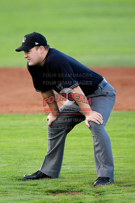 Base umpire Cameron Westover as the Ogden Raptors faced the Orem Owlz in Pioneer League play at Lindquist Field on August 28, 2013 in Ogden Utah.  (Stephen Smith/Four Seam Images)