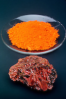 LEAD OXIDE AND CROCOITE<br /> Lead Oxide in Watchglass With Crocoite<br /> Lead oxide is often used in pigment. Crocoite is a mineral containing lead chromate.