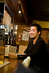 Kenji Suzuku, CEO of 47 Planning sits at the counter of his company's 47 Dining, a restaurant specializing in Fukushima cuisine and promoting produce from the stricken prefecture, in Tokyo,  Japan on 13 Nov. 2012. Photographer: Robert Gilhooly