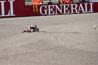 Jorge Lorenzo lies in the safety zone after violent accident when he was leading the race