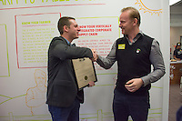 Wolf Starr of Connect Columbus shakes hands with Morgan Spurlock before presenting his with a proclamation from the state of Ohio congratulating him on the opening of his new restaurant.<br /> <br /> Morgan Spurlock opens &quot;Holy Chicken,&quot; a faux fast food restaurant in Columbus, Ohio, where a documentary crew recorded his interaction with customers who thought they were dining at a new type of fast food restaurant. However, the entire location was designed to be part of his documentary highlighting the marketing of food that may not be as healthy as it is stated in advertisement, banners, and notices at the restaurant.