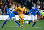Motherwell v St Johnstone...28.01.12  .Omar Daley gets between Fran Sandaza and Dave Mackay.Picture by Graeme Hart..Copyright Perthshire Picture Agency.Tel: 01738 623350  Mobile: 07990 594431