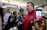NWA Democrat-Gazette/DAVID GOTTSCHALK  Head coach Bret Bielema (right) speaks with the media Wednesday, March 15, 2017, before the Arkansas Pro Day inside the Walker Pavilion on the campus of the University of Arkansas in Fayetteville.