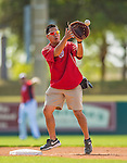 11 March 2013: Washington Nationals Medical Assistant John Hsu fields at second base prior to a Spring Training game against the Atlanta Braves at Space Coast Stadium in Viera, Florida. The Braves defeated the Nationals 7-2 in Grapefruit League play. Mandatory Credit: Ed Wolfstein Photo *** RAW (NEF) Image File Available ***