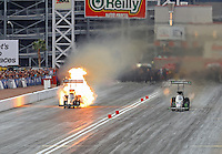 Oct 30, 2016; Las Vegas, NV, USA; NHRA top fuel driver Tripp Tatum has an engine fire alongside Brittany Force during the Toyota Nationals at The Strip at Las Vegas Motor Speedway. Mandatory Credit: Mark J. Rebilas-USA TODAY Sports