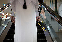 A person travels up an escalator at a shopping centre in Doha.