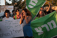 "Israeli left-wing activists protest outside a promotion event for new housing units in the Jewish neighborhood of Armon Hanatsiv in annexed east Jerusalem on August 11, 2013 attended by Israeli Housing Minister Uri Ariel, of the far-right Jewish Home party and Jerusalem Mayor Nir Barkat. Israel said it would issue tenders for 1,000 new settlements in the West Bank and east Jerusalem and Palestinians called this proof Israel is ""not serious"" about peace talks.   Photo by Oren Nahshon"