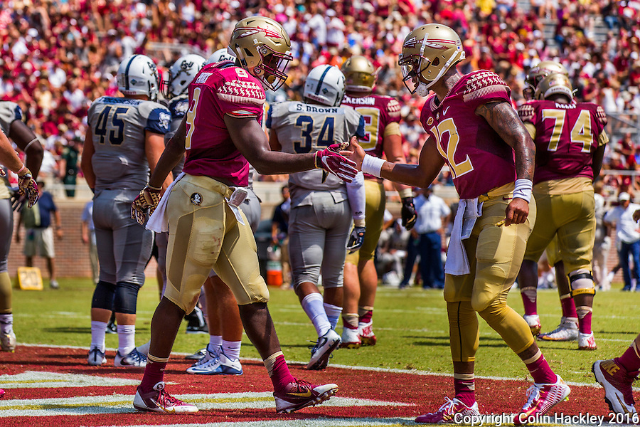 TALLAHASSEE, FLA 9/10/16-Florida State's Jacques Patrick, left, celebrates with quarterback Deondre Francois after he scored the Seminole's fifth touchdown against Charleston Southern during second quarter action Saturday at Doak Campbell Stadium in Tallahassee. <br /> COLIN HACKLEY PHOTO