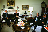 President Hosni Mubarak of Egypt, left, visits United States President George H.W. Bush, center left, in the Oval Office of the White House in Washington, D.C. on Monday, October 2, 1989.  Also attending the meeting are U.S. Secretary of State James A. Baker III, center right,  and U.S. Vice President Dan Quayle, right..Credit: Arnie Sachs / CNP