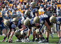 Pitt center Alex Karabin (61) readies the Pitt offense. The Pittsburgh Panthers defeated the Rutgers Scarlet Knights 41-21 on October 23, 2010 at Heinz Field, Pittsburgh, Pennsylvania....