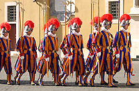 THE SWISS GUARDS IN THEIR COLOURFUL UNIFORMS.MARCHING IN THE VATICAN CITY