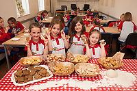 Rainbows learn to make bread at ASDA Newark - pictured from left are Gracie Brooks, 6, Sophie Edwards, 6, Maise Mullet, 6 and Lacey Goy, 6