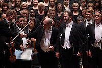 Music Director and Conductor Robert Spano, left, with Tenor Thomas Cooley and Baritone Stephen Powell, right, with the Atlanta Symphony Orchestra and Chorus performing Benjamin Britten's War of Requiem at Carnegie Hall in New York, NY on April 30, 2014.