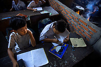 Students at Kartini Emergency School during class. Since the early 1990s, twin sisters Sri Rosyati (known as Rossy) and Sri Irianingsih (known as Rian) have used their family inheritance to set up and run 64 schools in different parts of Indonesia, providing primary education combined with practical skills to some of the country's most deprived children.