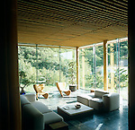 The peaceful and elegant sitting room has modular sofas and a pair of Marc Newson designed chairs in wicker