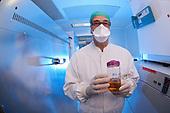 Scientist holding Sputnik Virus solution.