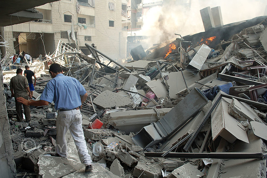 Local view the destruction in the Muawwad district of South Beirut after a night of Israeli Bombing.