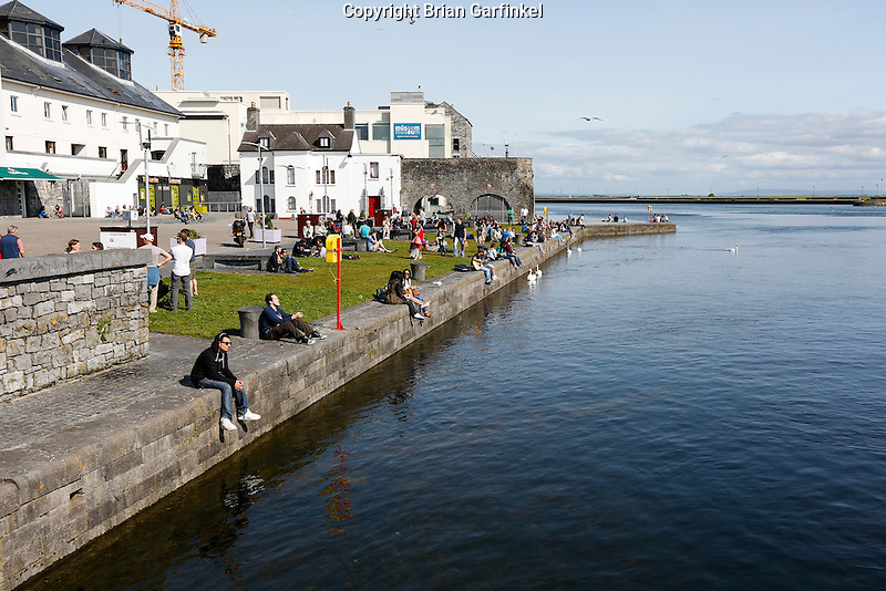 People relax on the side of the River Corrib in Galway, County Galway, Ireland on Monday, June 24th 2013. (Photo by Brian Garfinkel)