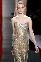 Carolina walks runway in a strapless golden silver embroidered gown, from the Reem Acra Fall 2012 Feminine Power collection fashion show, during Mercedes-Benz Fashion Week New York Fall 2012 at Lincoln Center.