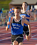 WINSTED, CT-041817JS12- Lewis Mills' Jon Lewis takes the baton from teammate Riley McNaboe to anchor their winning 4x400M relay during their meet against Gilbert and Litchfield Tuesday at Northwest Regional High School in Winsted. <br /> Jim Shannon Republican-American