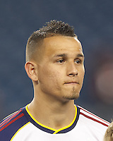 Real Salt Lake midfielder Luis Gil (21). In a Major League Soccer (MLS) match, Real Salt Lake (white)defeated the New England Revolution (blue), 2-1, at Gillette Stadium on May 8, 2013.