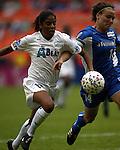 Maribel Dominguez (13) and Jennifer Grubb (14) at RFK Stadium in Washington, DC on 4/26/03 during a game between the Atlanta Beat and Washington Freedom