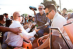 """Filmmaker George Lucas signs autographs before the American Graffiti Parade in Modesto, California, June 7, 2013. Modesto is celebrating the 40th anniversary of the film """"American Graffiti"""", with a parade headed up by native son, filmmaker George Lucas."""