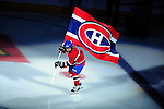 15 October 2009: A young skater in a Montreal Canadiens uniform skates with the team flag prior to a game against the Colorado Avalanche at the Bell Centre in Montreal, Quebec, Canada. The Avalanche edged out the Habs 3-2 in Montreal's season home opener. Mandatory Credit: Ed Wolfstein Photo