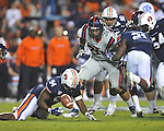 Auburn defensive end Nosa Eguae (94) recovers a fumble vs. Ole Miss at Jordan-Hare Stadium in Auburn, Ala. on Saturday, October 29, 2011. Auburn won 41-23..