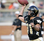 2 September 2006: Wake Forest quarterback Riley Skinner throws a pass in pregame warmup.  Skinner replaced Benjamin Mauk (not pictured) after Mauk sustained an arm injury during the third quarter. Wake Forest defeated Syracuse 20-10 at Groves Stadium in Winston-Salem, North Carolina in an NCAA college football game.