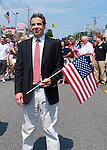 MAY 30, 2011 - Little Neck, New York, U.S. - New York Governor ANDREW CUOMO (Democrat) stands holding American flag during pause in Little Neck-Douglaston Memorial Day Parade, which honors America's veterans, on Northern Boulevard.