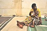 Dusabe Kuhurindira cares for her daughter Judithe in a cholera clinic run by Médecins Sans Frontières for people displaced by fighting in eastern Congo. The clinic is located in Bobandana, a village outside the town of Minova, in the eastern Congo's South Kivu province. A quarter of a million people have been newly displaced by fighting in the eastern Congo, where some 5.4 million have died since 1998 from war-related violence, hunger and disease. .