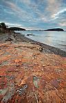 Colorful Bar Harbor Formation rock leads into Bar Harbor on Mount Desert Island, Maine, USA