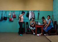 Women take a break after selecting tobacco leaves at a warehouse in the western province of Pinar del Rio, San Juan, Cuba, February 28, 2017. Tourists from around the world visit to Cuba during the annual festival of the cigar, celebrate from February 27 to 3 of March.  VIEWpress/Eliana Aponte.