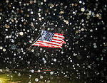 SHELL POINT BEACH, FL - SEPTEMBER 01:  A US flag is bent by the wind as the eye of Hurricane Hermine passes overhead in Shell Point Beach, Florida September 1, 2016.  Hurricane warnings have been issued for parts of Florida's Gulf Coast as Hermine makes landfall here as a Category 1 hurricane.  (Photo by Mark Wallheiser/Getty Images)