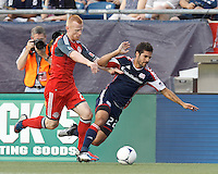 Toronto FC defender Richard Eckersley (27) ends New England Revolution forward Benny Feilhaber (22) dribble down the wing. In a Major League Soccer (MLS) match, Toronto FC defeated New England Revolution, 1-0, at Gillette Stadium on July 14, 2012.