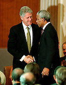 Washington, DC - September 23, 1998 -- United States President Bill Clinton congratulates President Nelson Mandela of South Africa after the latter's speech accepting the Congressional Gold Medal in the United States Capitol Rotunda on Wednesday, September 23, 1998...Credit: Ron Sachs / CNP